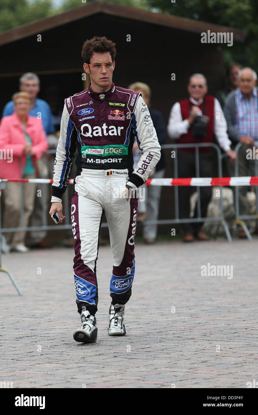 Belgian rally driver Thierry Neuville walks past an audience after the 15th special stage of the ADAC German Rally - Stock Image