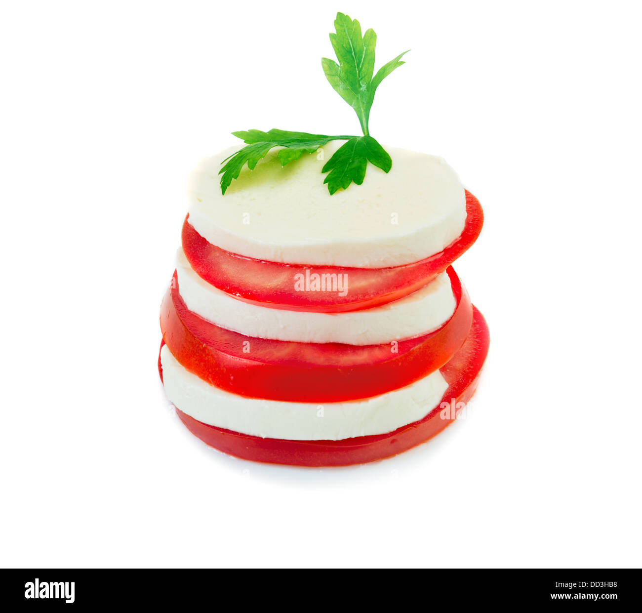 Mozzarella and tomato slices arranged in stack isolated over white - Stock Image