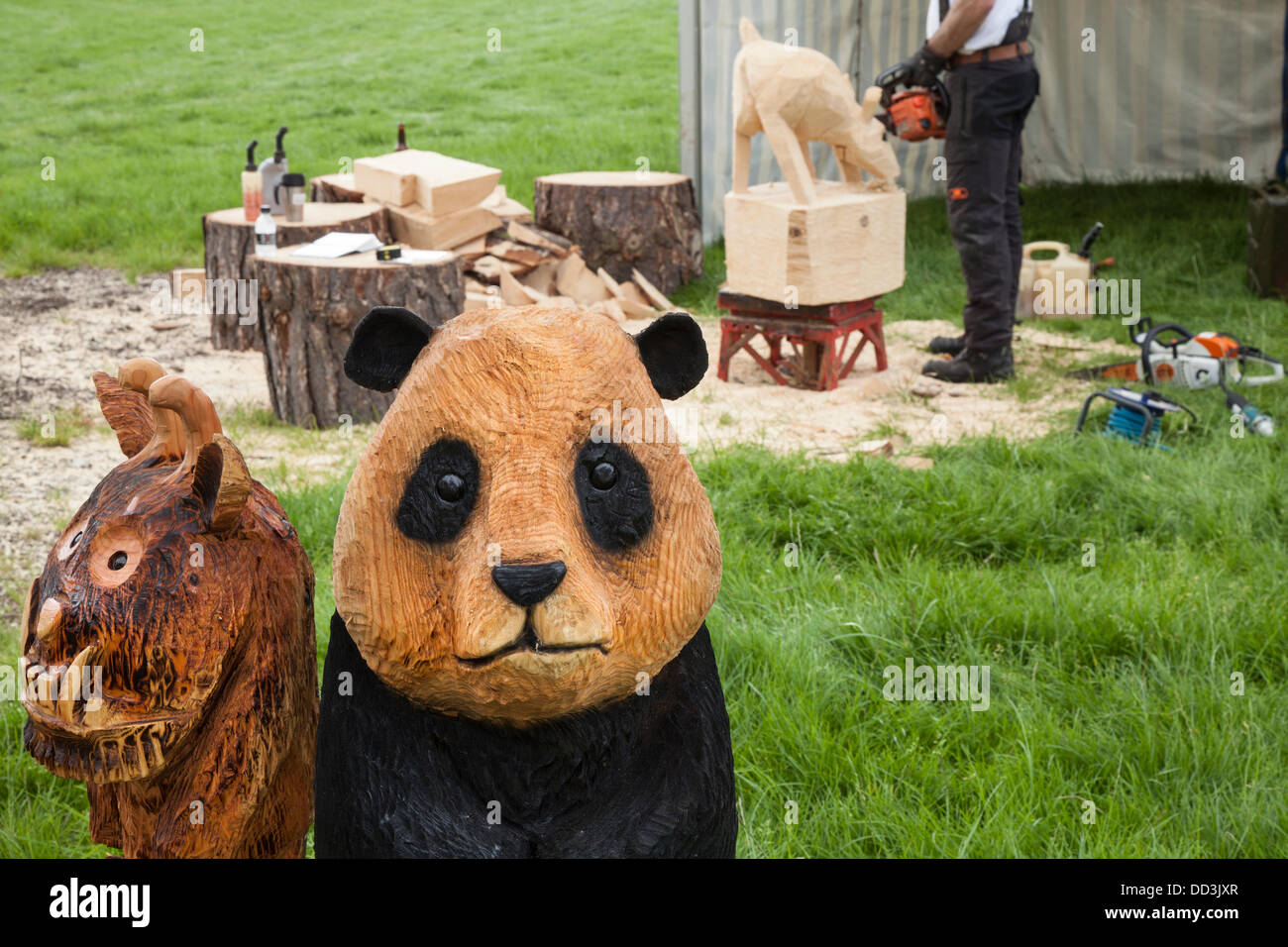 Cheshire Game & Country Fair, UK,  Aug 24 to Aug 26, 2013.  Chainsaw carved figures at the 6th Tabley Cheshire - Stock Image