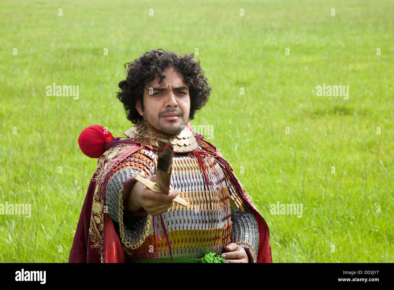 Mr Naddem Ahmed, (MR)  bearded,  23,  from Nottingham a re-enactor dressed wearing traditional historic Persian - Stock Image