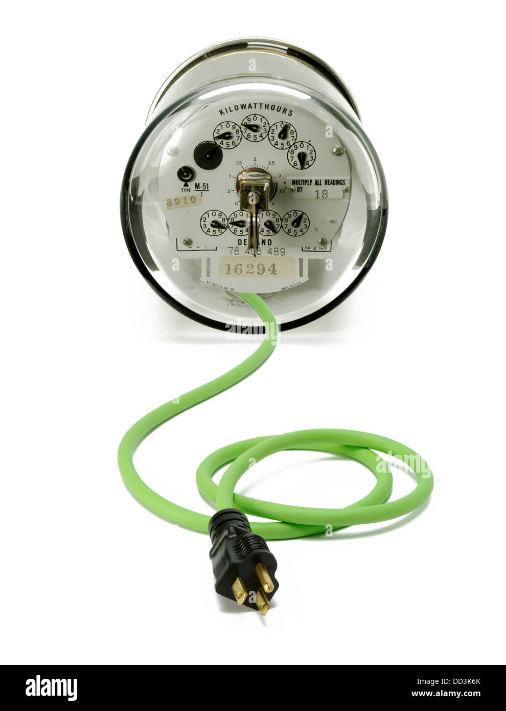 An electrical meter with a green cord and plug - Stock Image