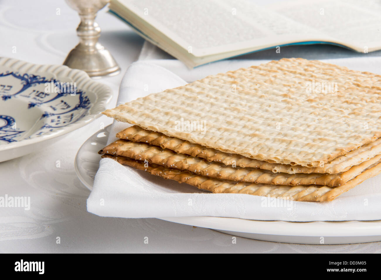 Closeup of Matzah on Plate which is the unleaven bread served at Jewish Passover dinners - Stock Image