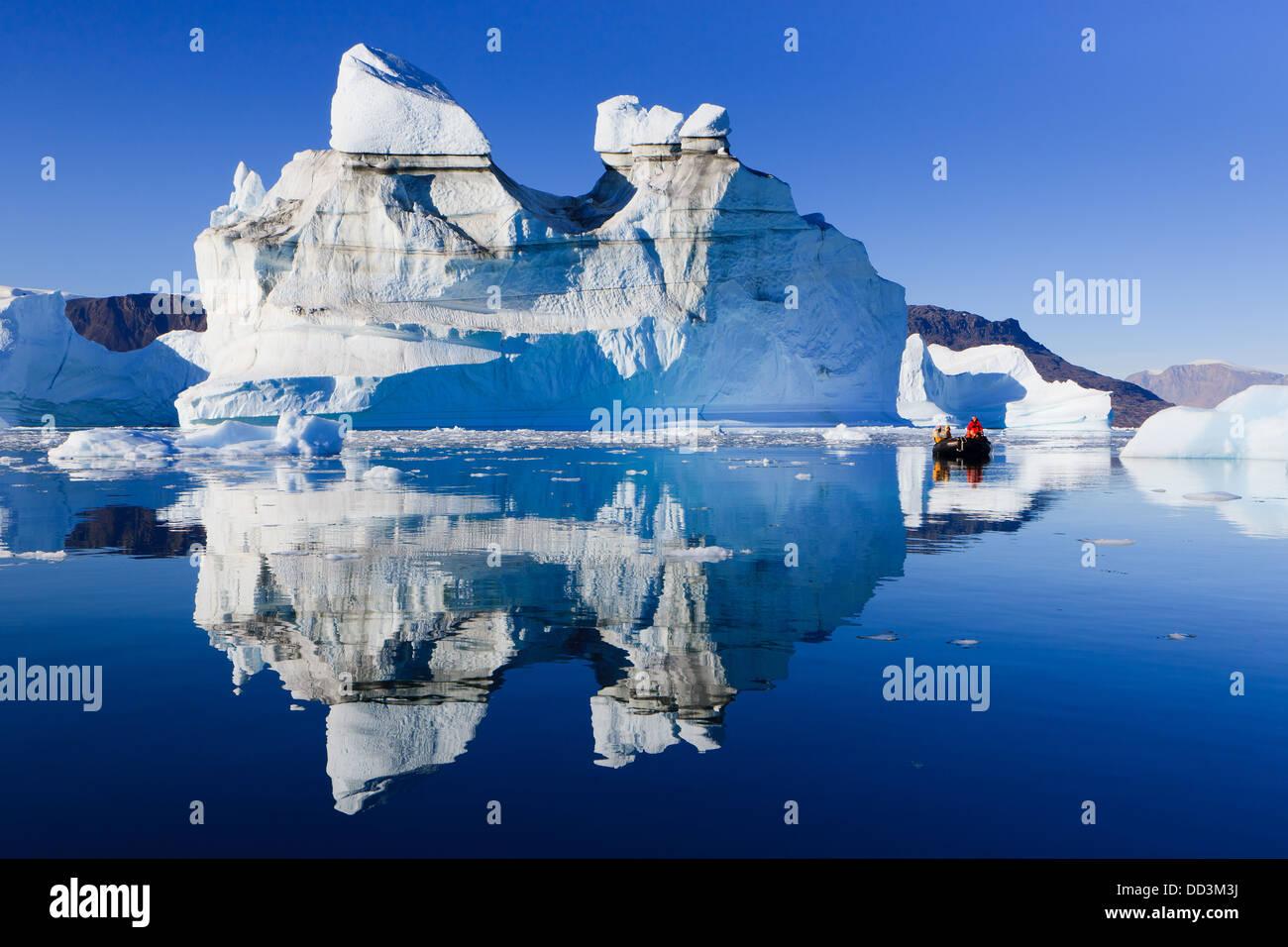 Cruising between the icebergs at Røde Ø, Scoresby sund, Greenland - Stock Image
