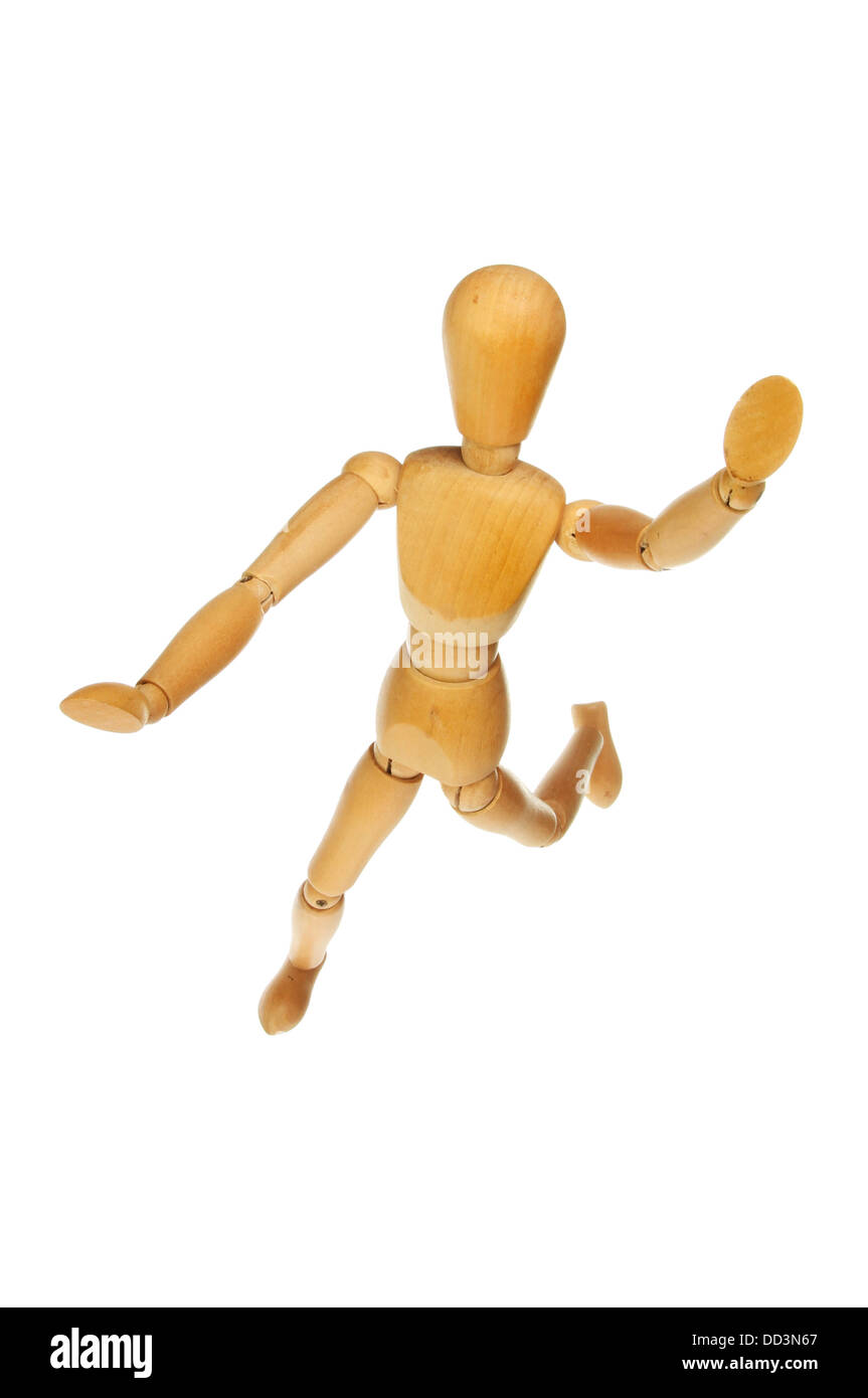 Artist's wooden mannikin leaping througth the air isolated against white - Stock Image
