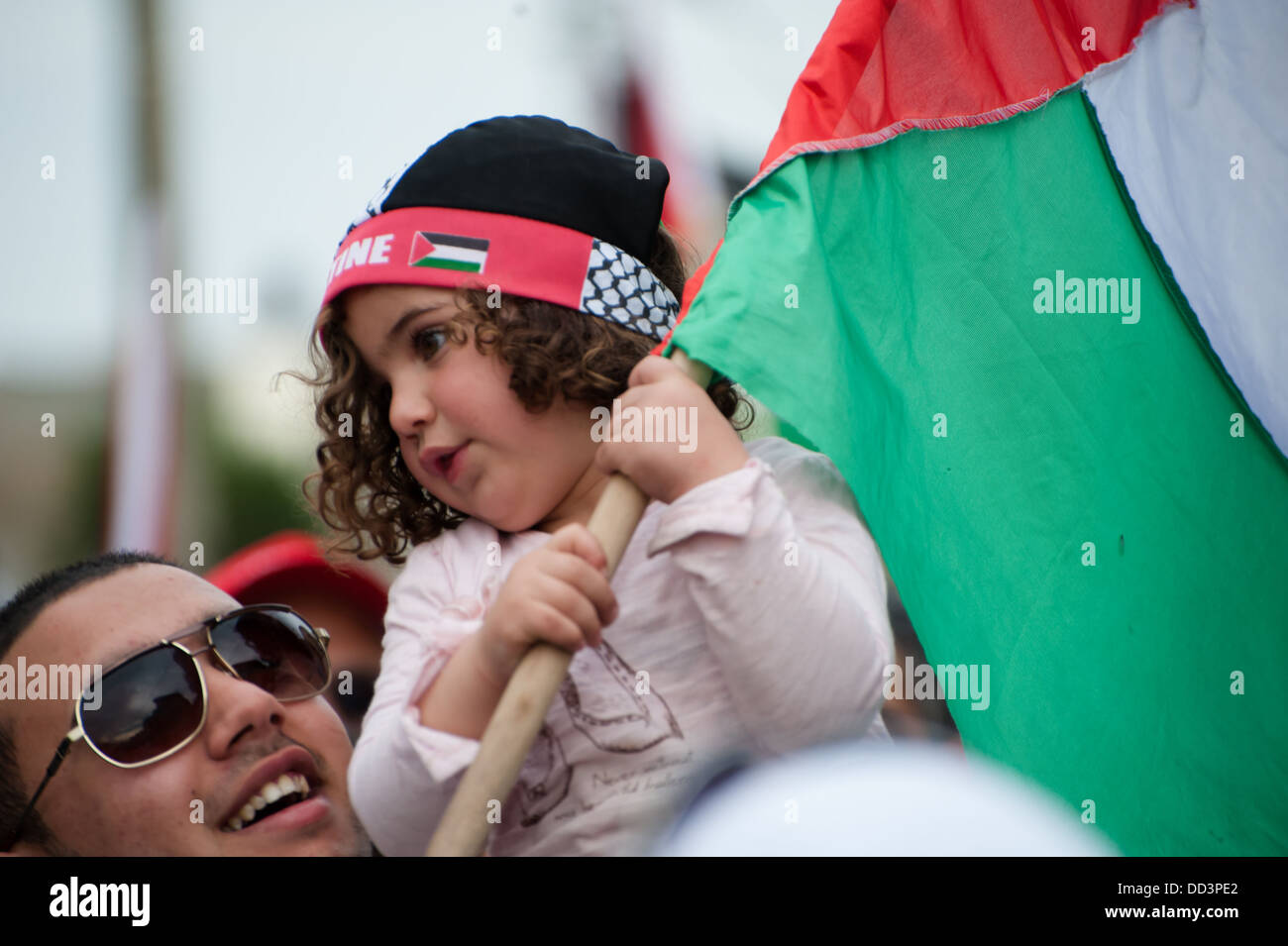 Palestinian youth from the Galilee town of Sakhnin march during a Land Day demonstration. - Stock Image