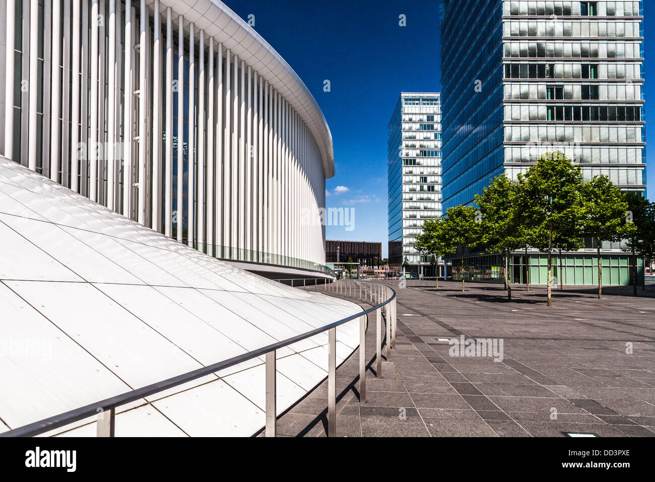 Part of the Philharmonie concert hall and the towers of the European Parliament buildings at Kirchberg in Luxembourg - Stock Image