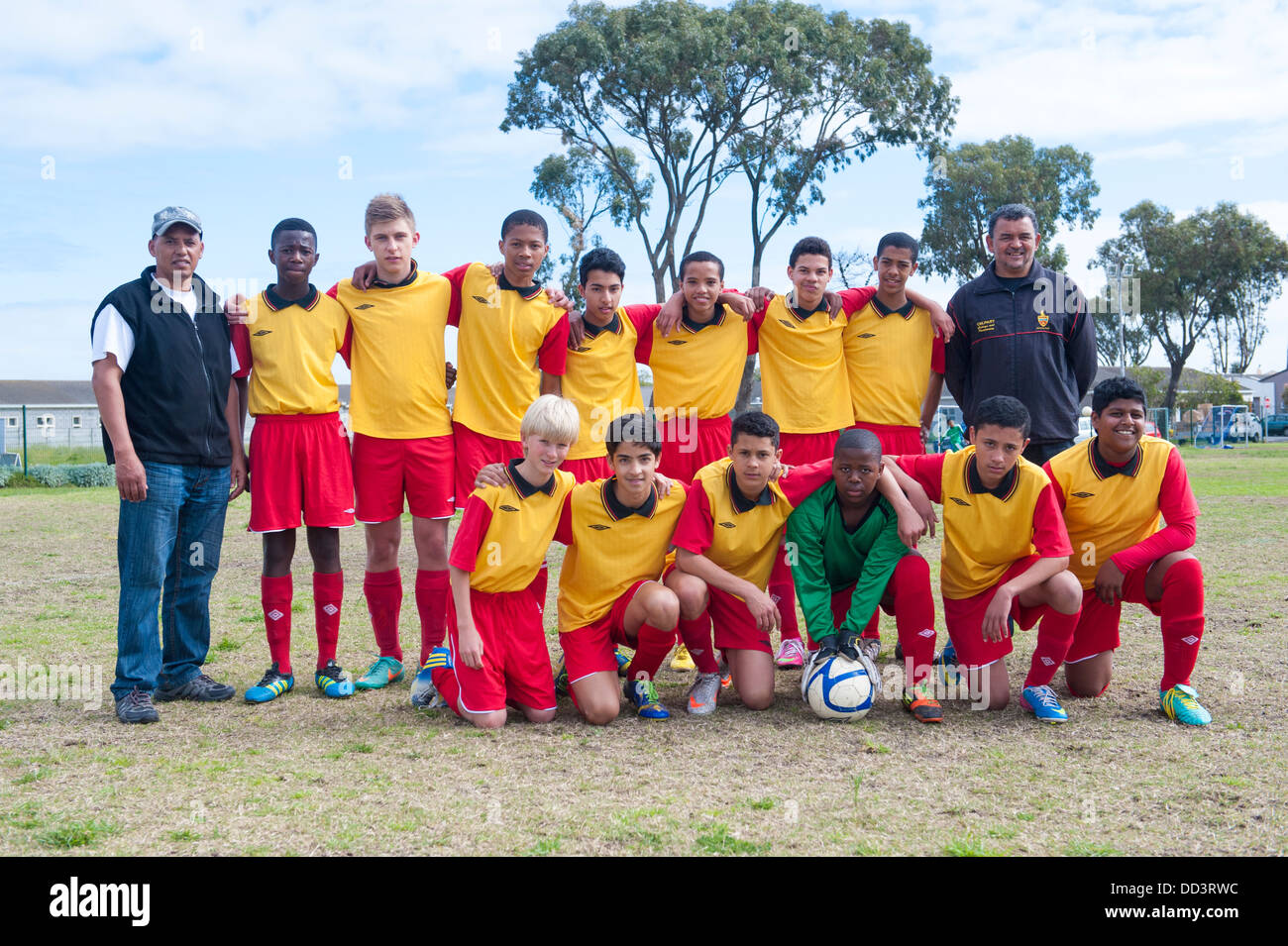 Team photo of Rygersdal U15B juniors with coach and assistant, Cape Town, South Africa - Stock Image