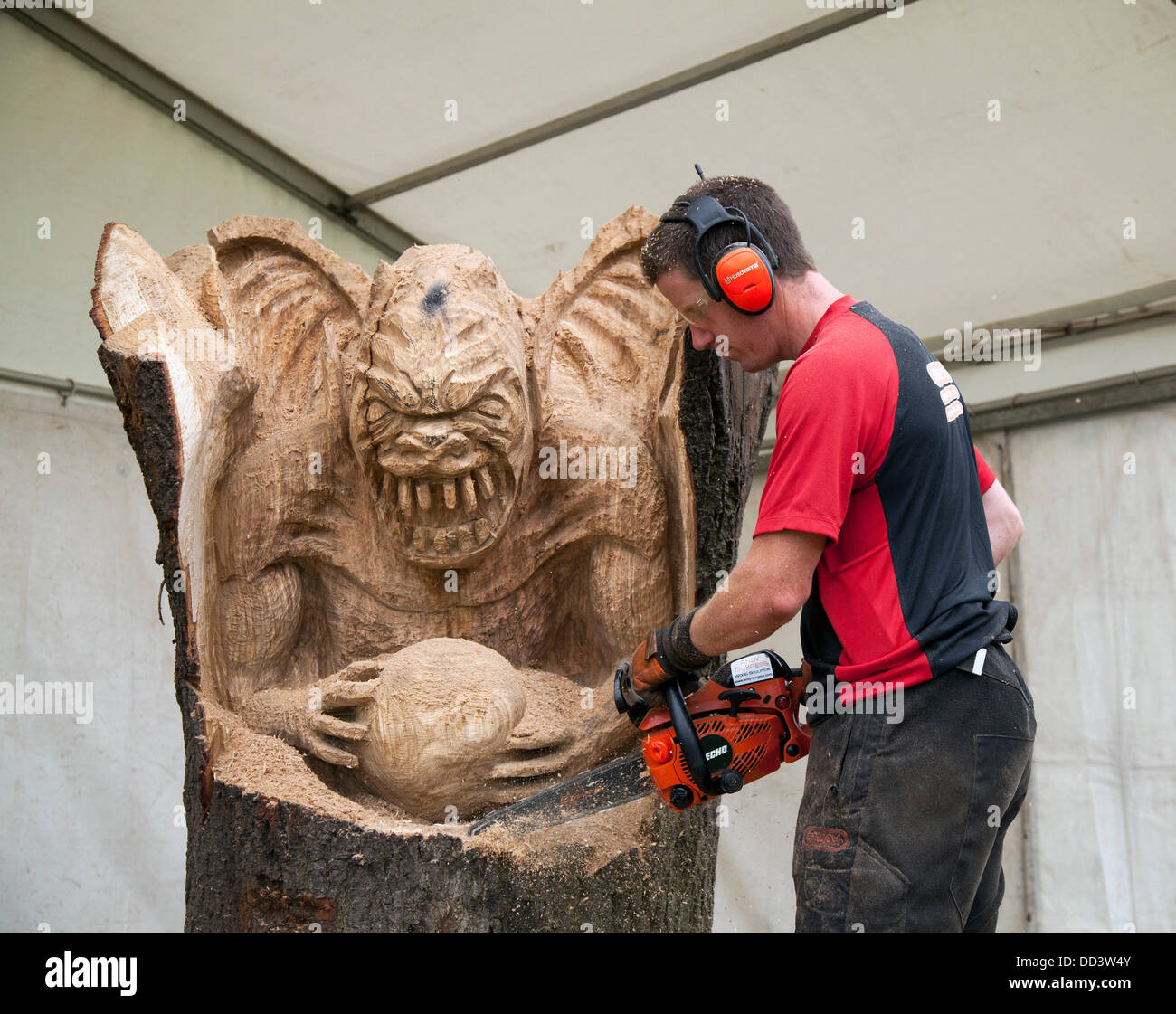 Tabley, Cheshire, UK 25th August, 2013. Andy Burgess & Yoda at the 9th English Open Chainsaw Carving Competition, - Stock Image