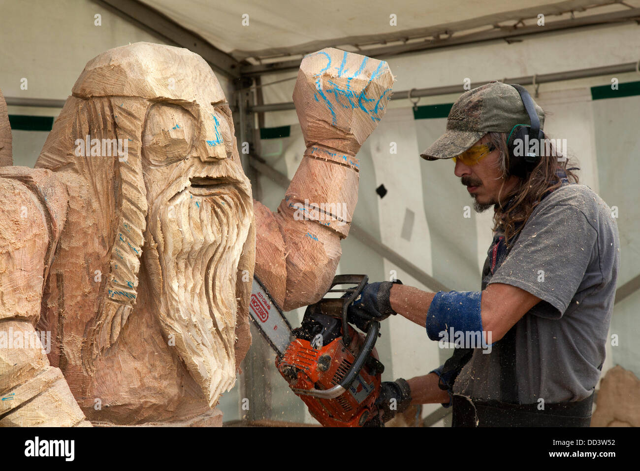 Tabley, Cheshire, UK 25th August, 2013. Viking figure carved by Bruce Thor from the USA at the 9th English Open - Stock Image
