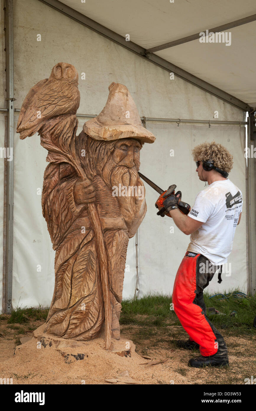 Tabley, Cheshire, UK 25th August, 2013. Ryan Cook from Canada at the 9th English Open Chainsaw Carving Competition, - Stock Image