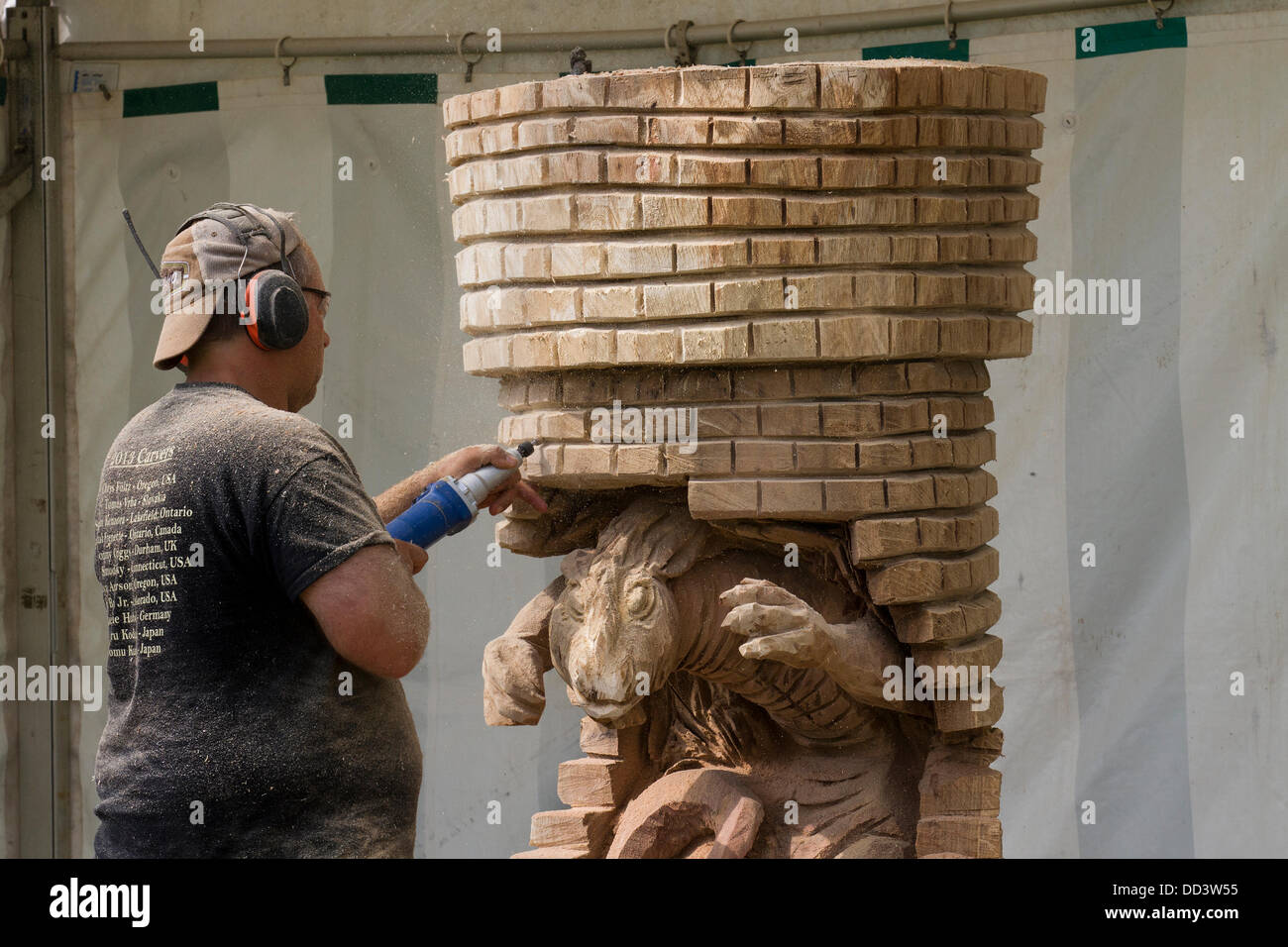 Tabley, Cheshire, UK 25th August, 2013. Steven Kenzora from Canada at the 9th English Open Chainsaw Carving Competition, - Stock Image