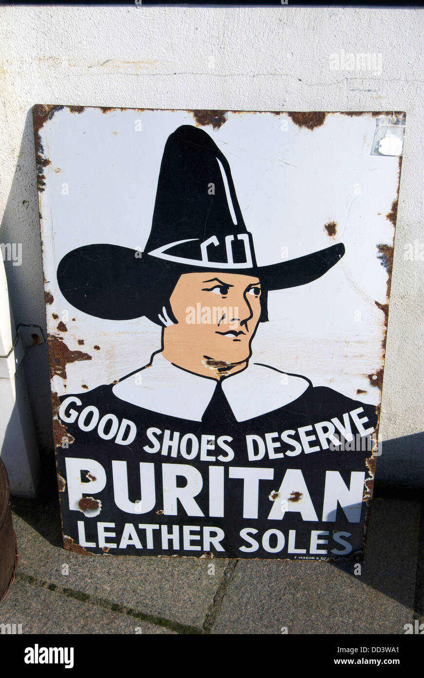 An old metal advertising sign for Puritan Leather Soles - Stock Image