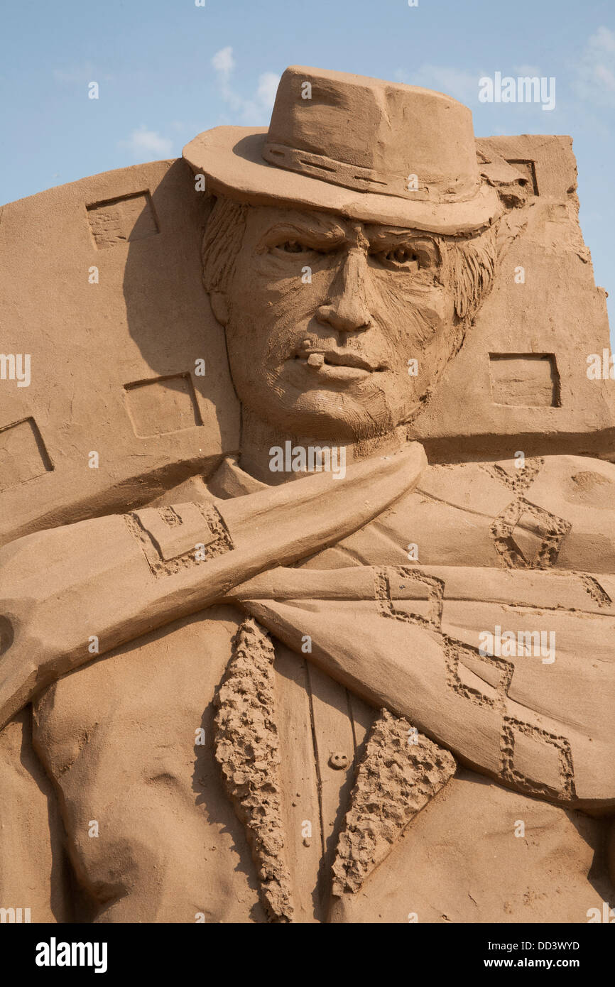 Clint Eastwood sand sculpture at the Hollywood themed Weston Sand Sculpture Festival 2013, Weston Super Mare Somerset - Stock Image