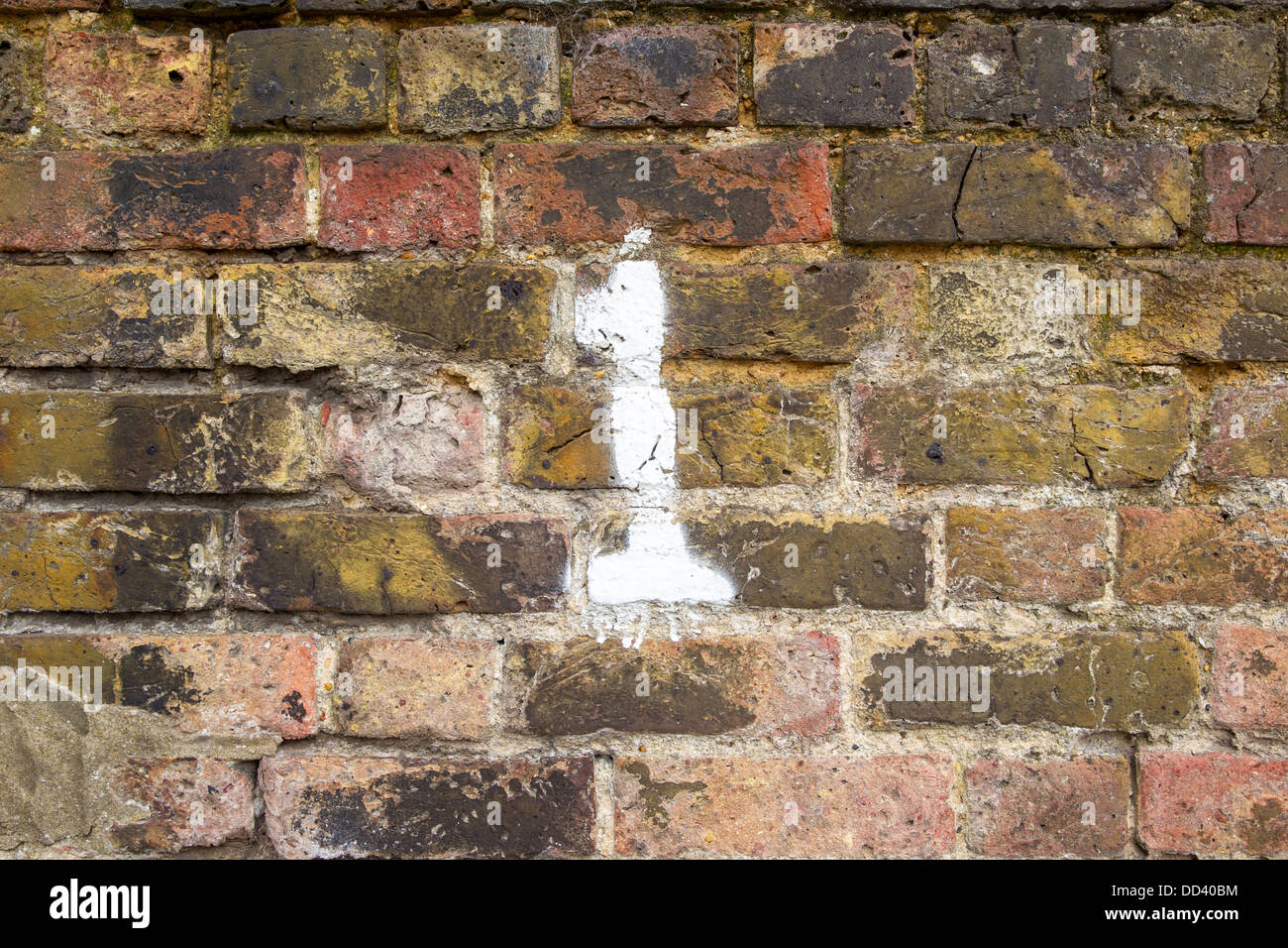 NUMBER 1 ON PAINTED ON A BRICK WALL, SOUTHEND-ON-SEA, ESSEX, UK - Stock Image