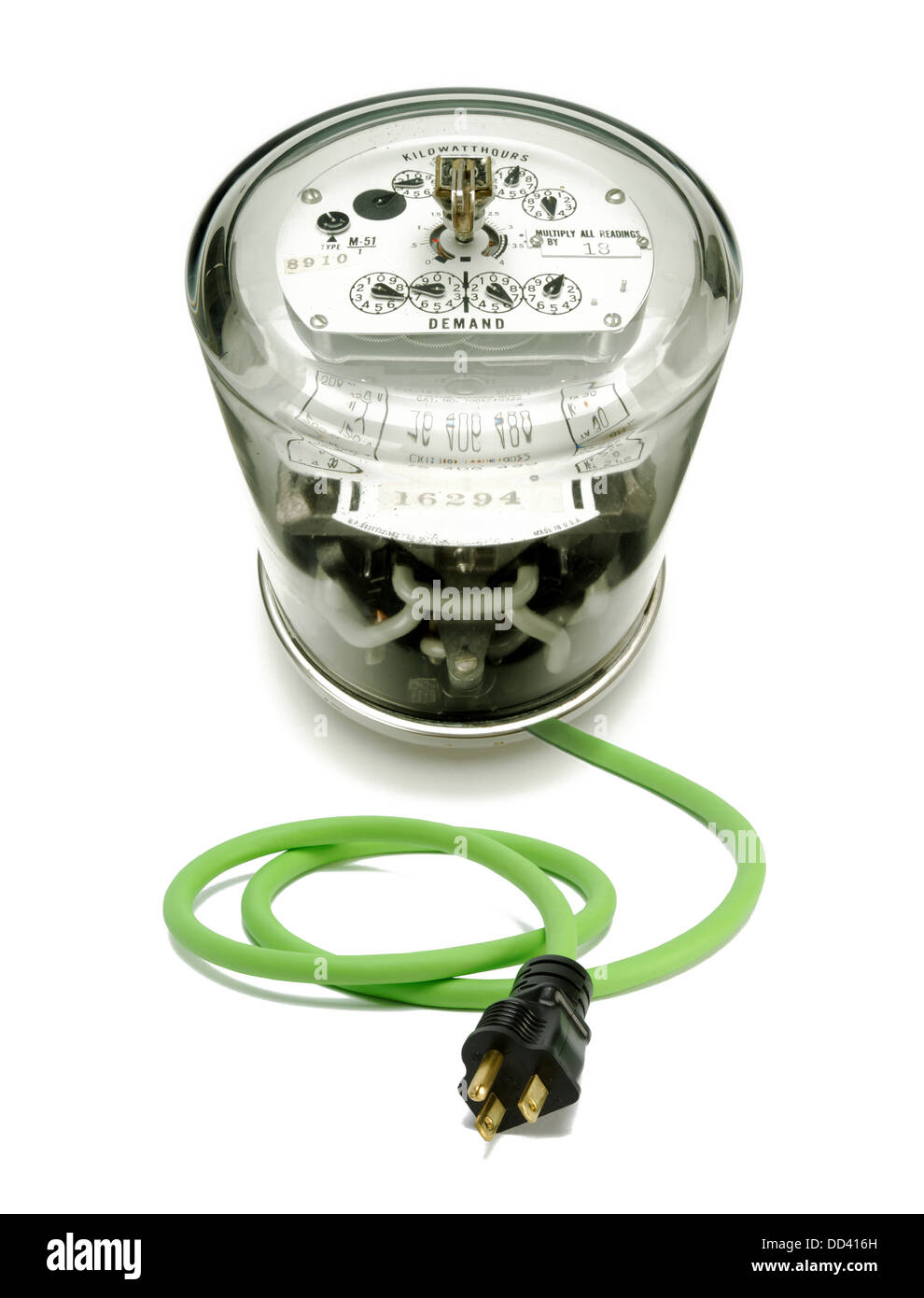 An electrical meter with a green cord and plug Stock Photo
