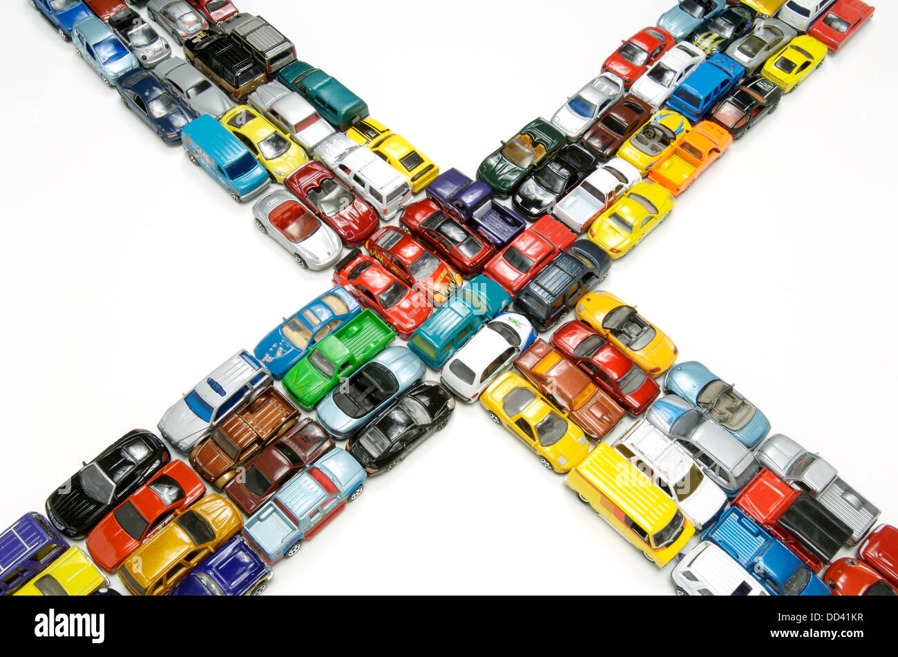 A traffic jam of miniature toy cars at an intersection. - Stock Image