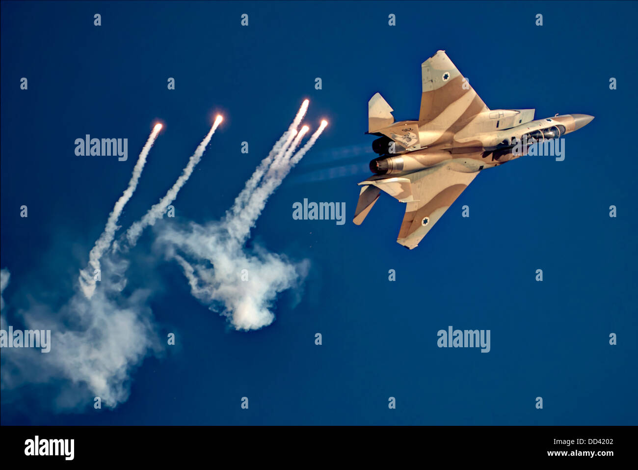 Israeli Air force (IAF) Fighter jet F-15I (Raam) in flight Emitting anti-missile flares - Stock Image