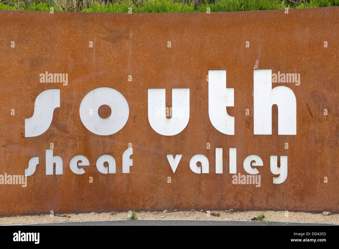 Sign on deliberately rusted metal. Typography - Stock Image