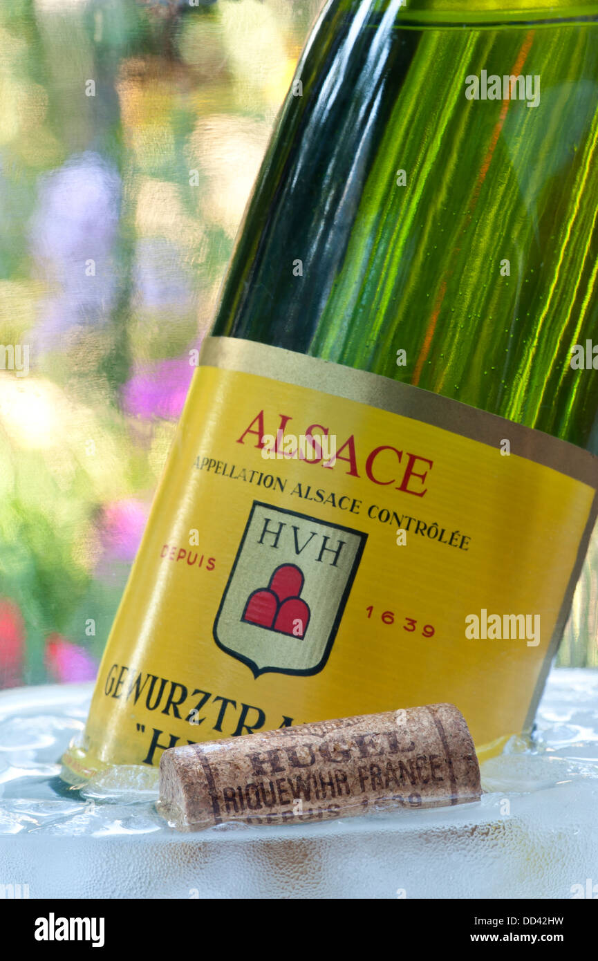 'Hugel' Gewurztraminer white wine bottle and cork in wine cooler in alfresco situation Riquewihr Alsace France Stock Photo