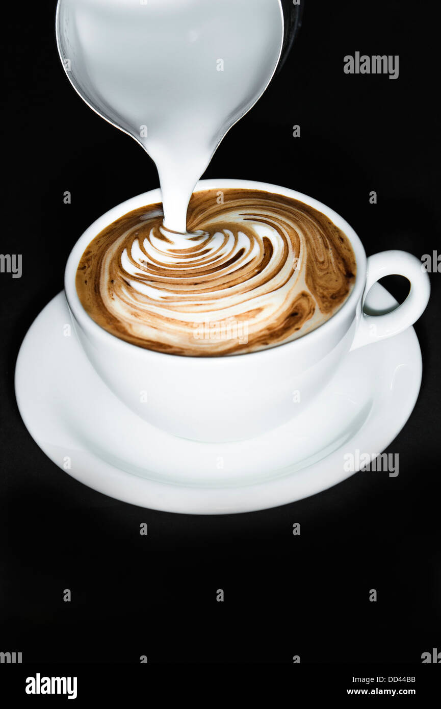 A cup of Mocha coffee in the process of being made - Stock Image
