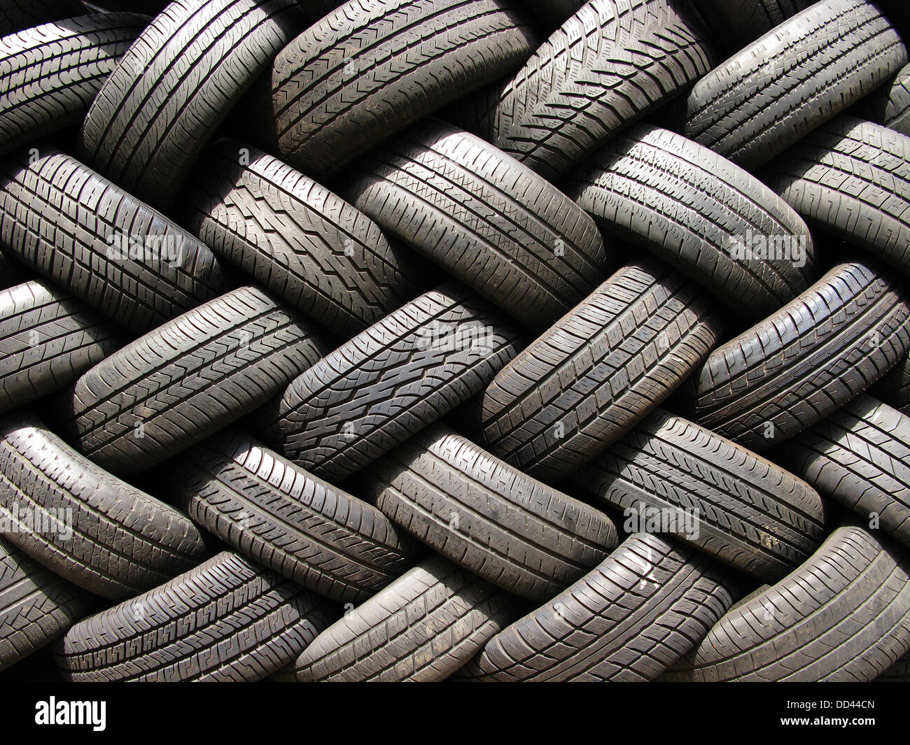 A large stack of used automotive car tires. - Stock Image