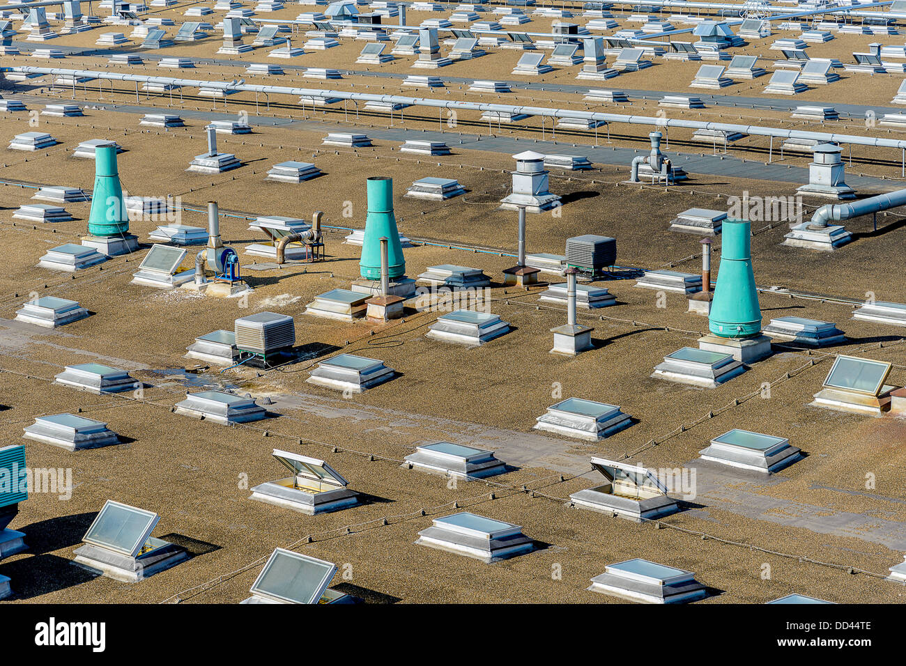 Roof of an industrial complex with ventilation installation and lighting transoms - Stock Image