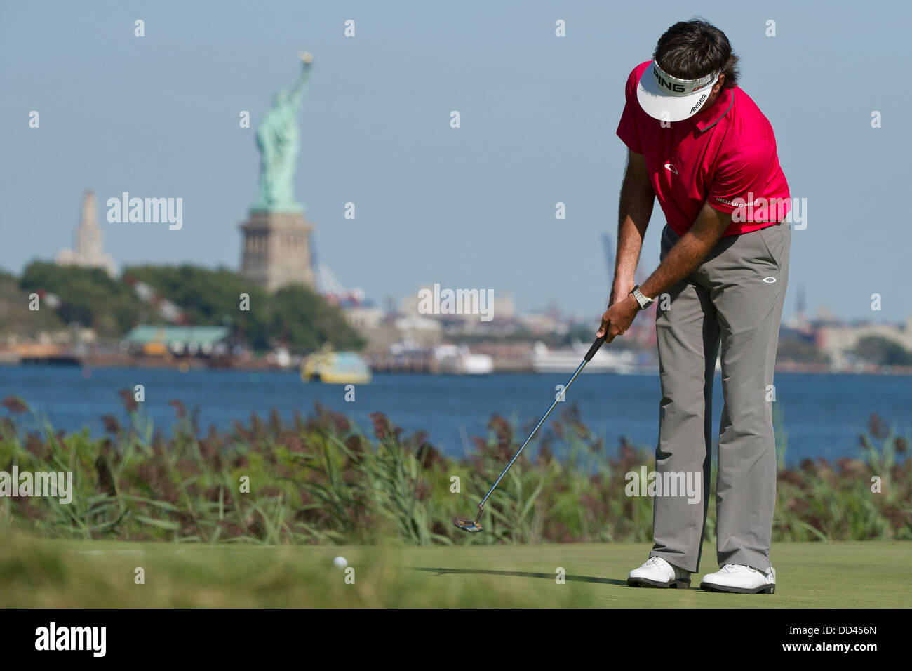 Jersey City, New Jersey, USA. 25th Aug, 2013. August 25, 2013: Bubba Watson (USA) puttsl on the 14th green in front Stock Photo