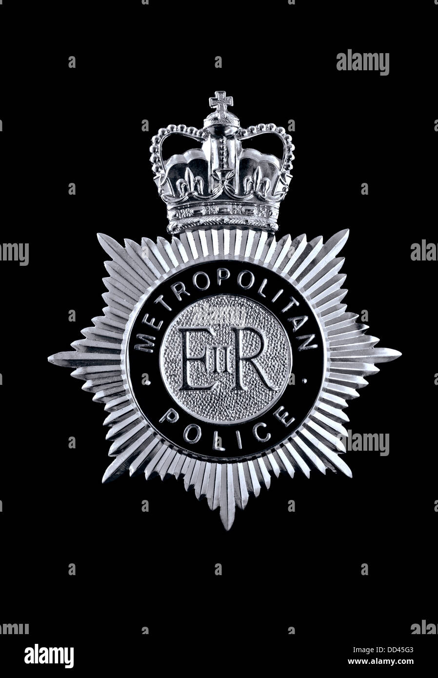 Close view on Metropolitan Police helmet badge on black background - Stock Image