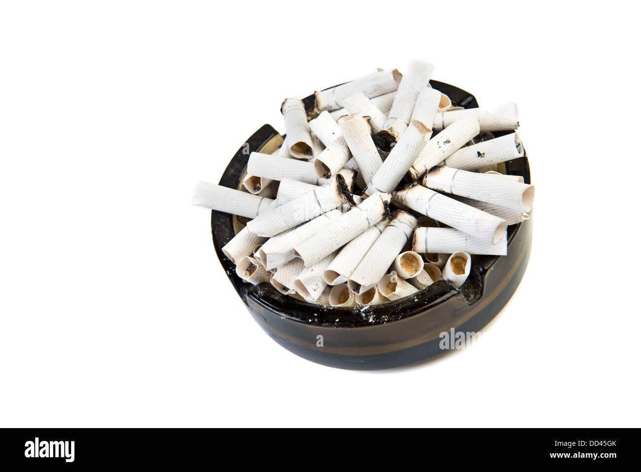 ashtray with many cigarettes on white background Stock Photo