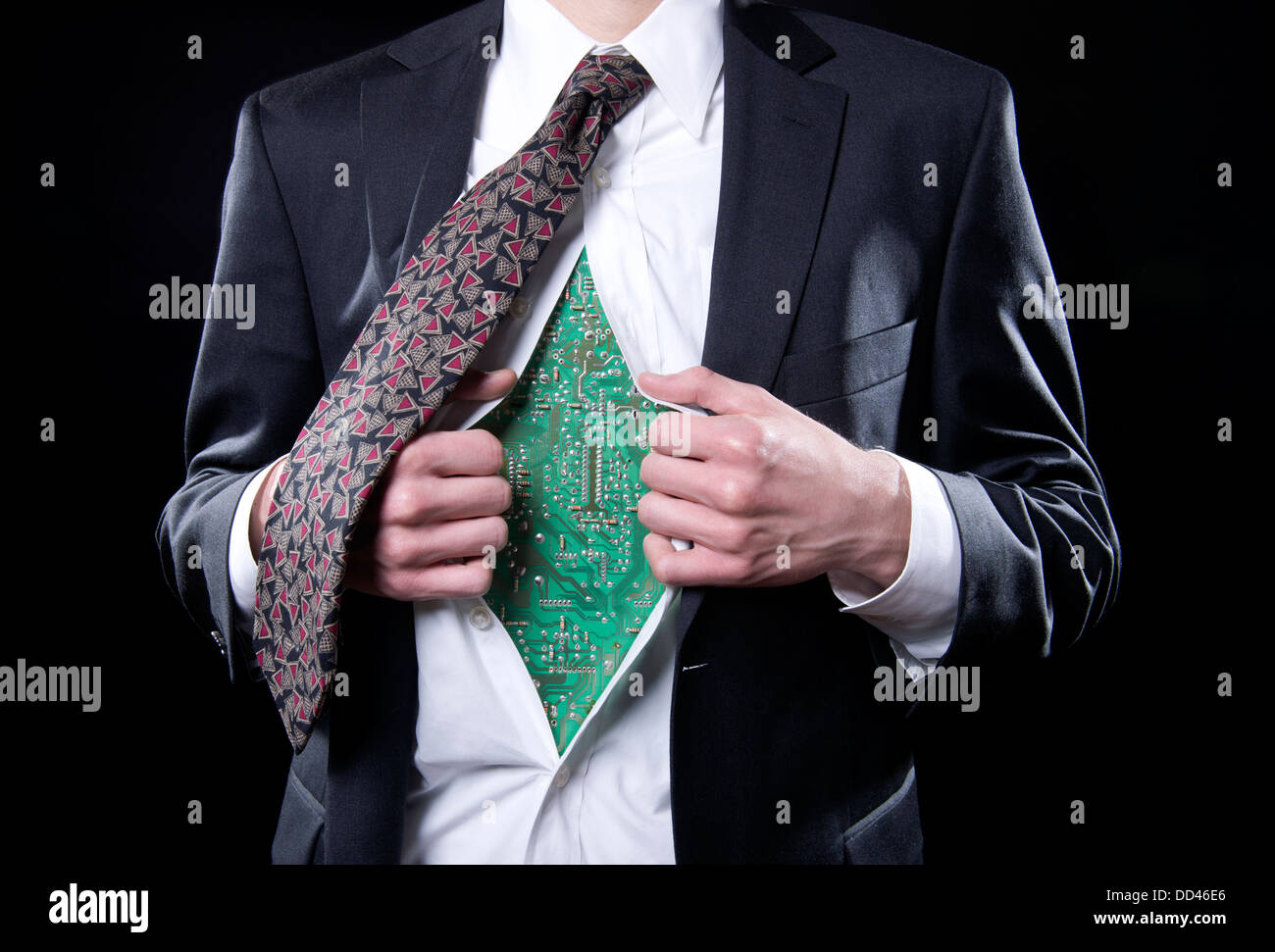 Concept photo for the bionic businessman showing a computer circuit board under the executive's shirt - Stock Image