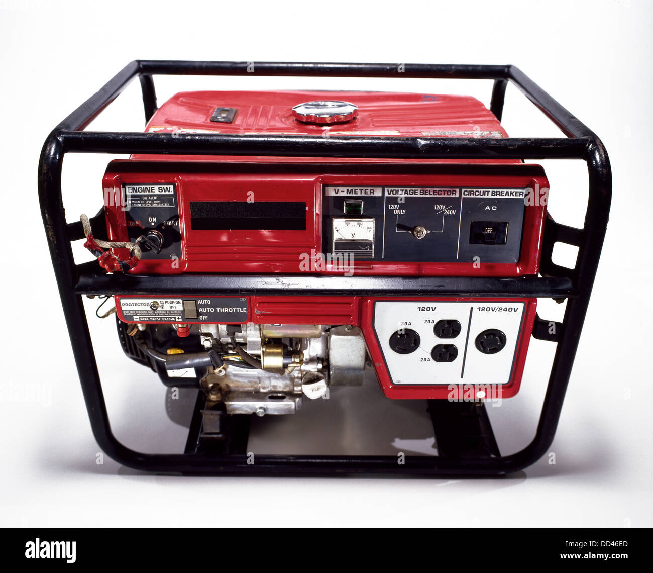 A red portable gas powered electric generator on a white background. - Stock Image