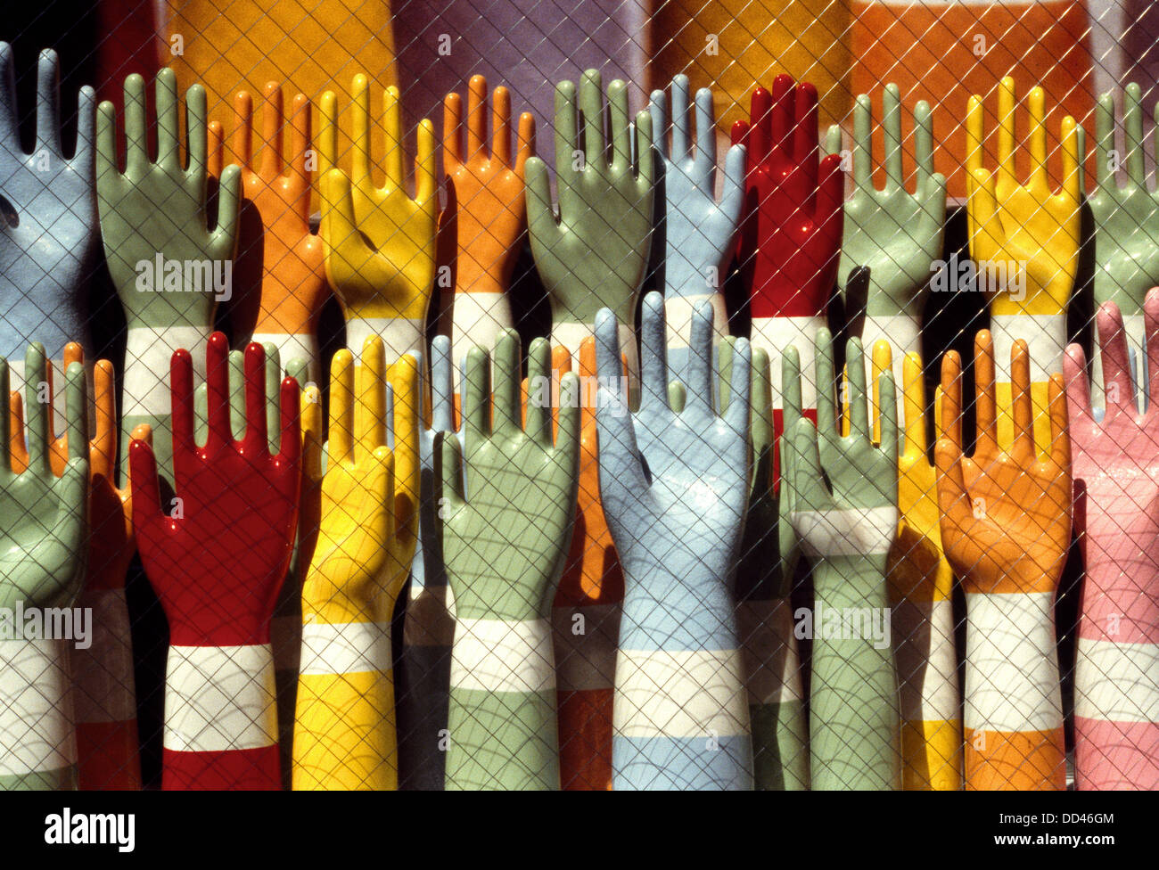 Colorful mannequin hands in a window - Stock Image