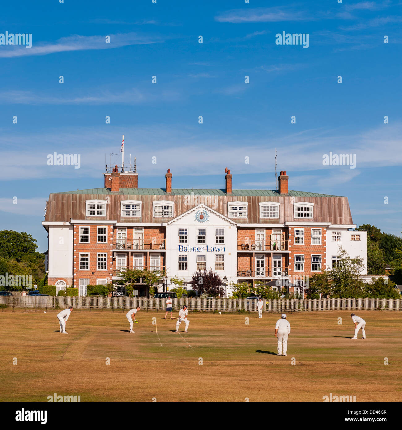 A cricket match takes place outside the Balmer lawn Hotel in Brockenhurst , Hampshire , England , Britain , Uk - Stock Image