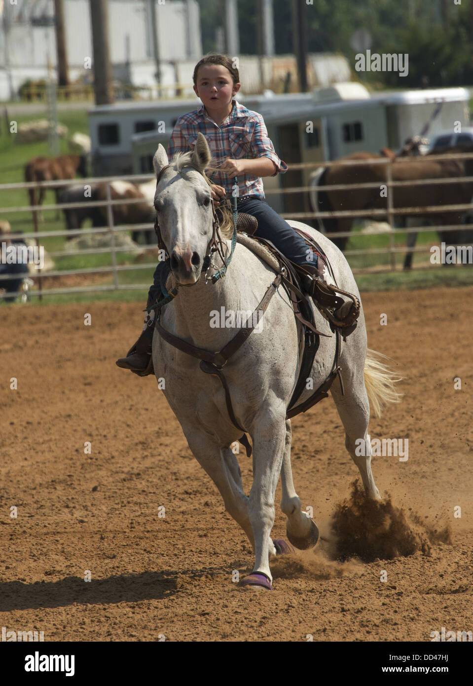 young cowgirl riding competition in Ada, Oklahoma - Stock Image