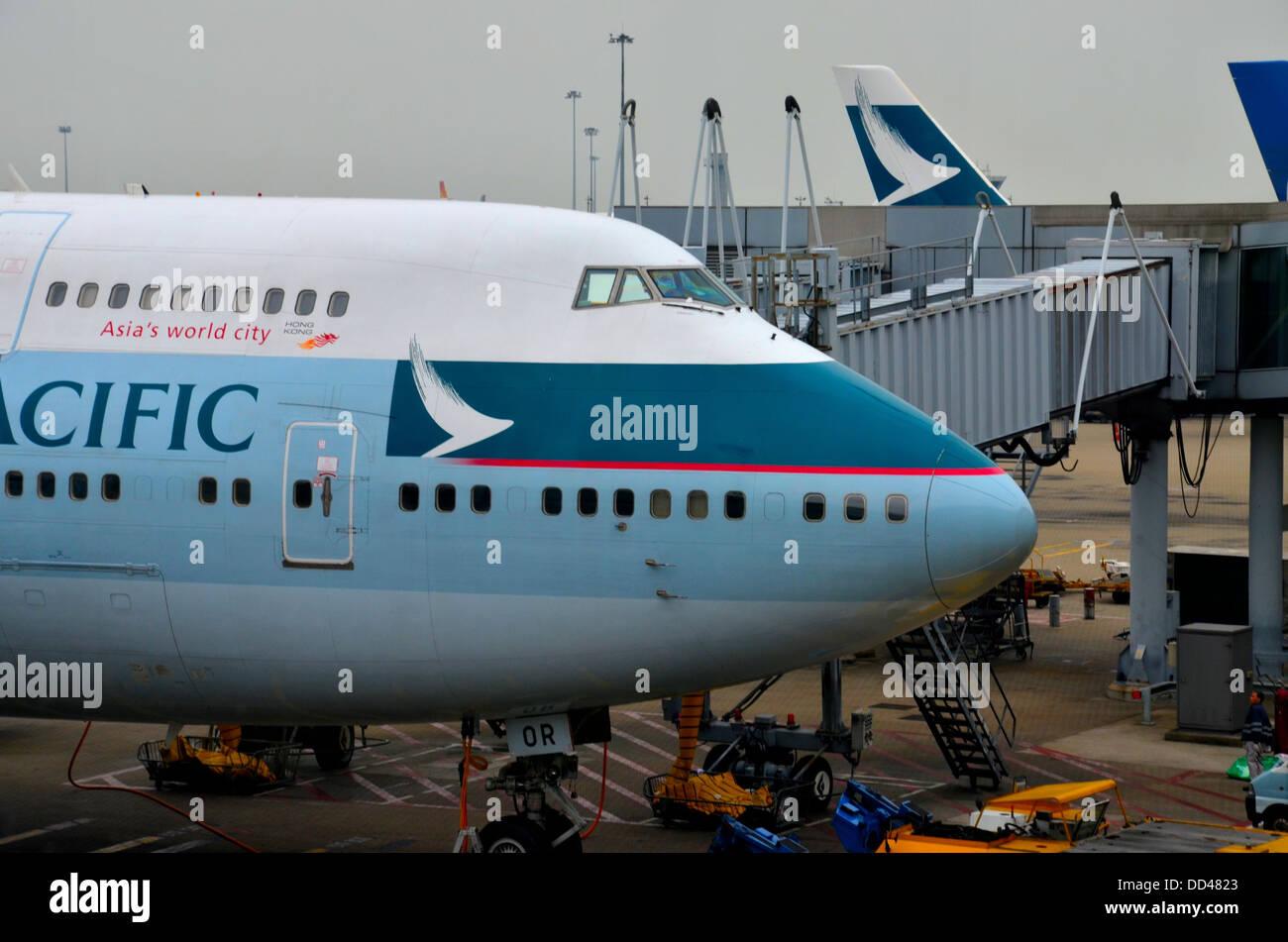 Cathay Pacific 747 jumbo jet parked at Hong Kong airport - Stock Image