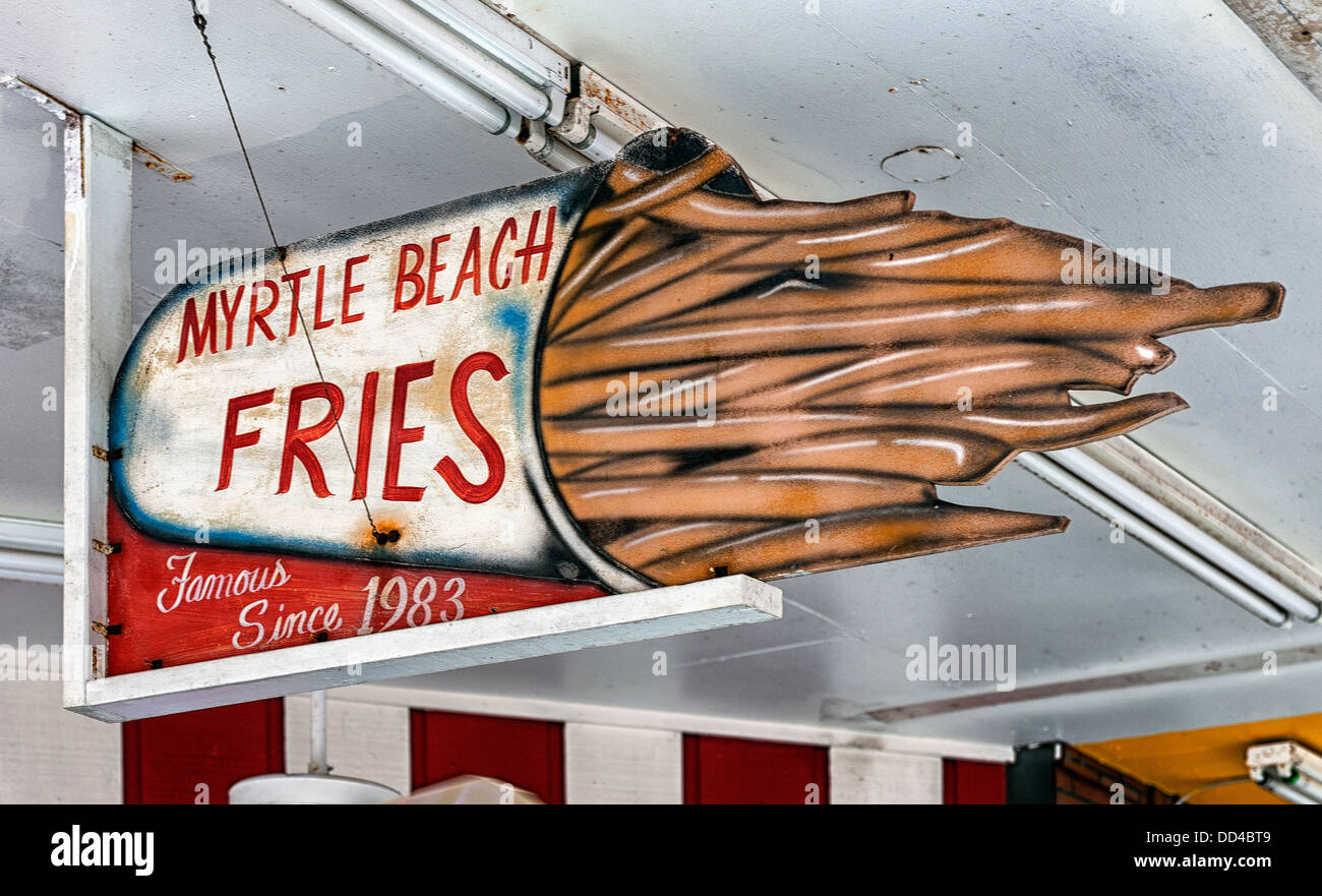 Fries an old school folk art sign on the boardwalk at Myrtle beach - Stock Image