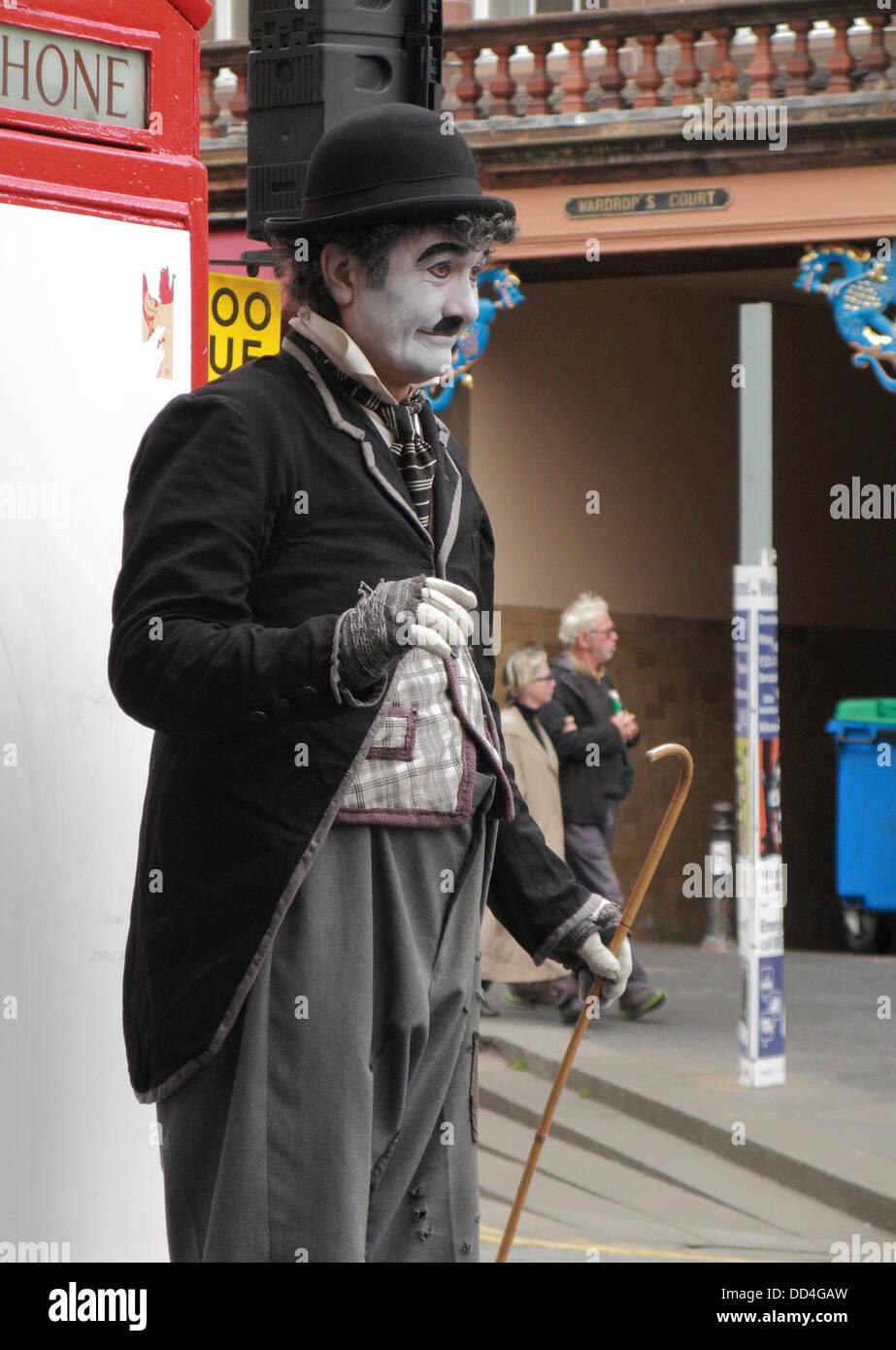 Charlie Chaplin Impersonator during the Edinburgh Fringe Festival, Lawnmarket, The Royal Mile, Edinburgh, Scotland, - Stock Image