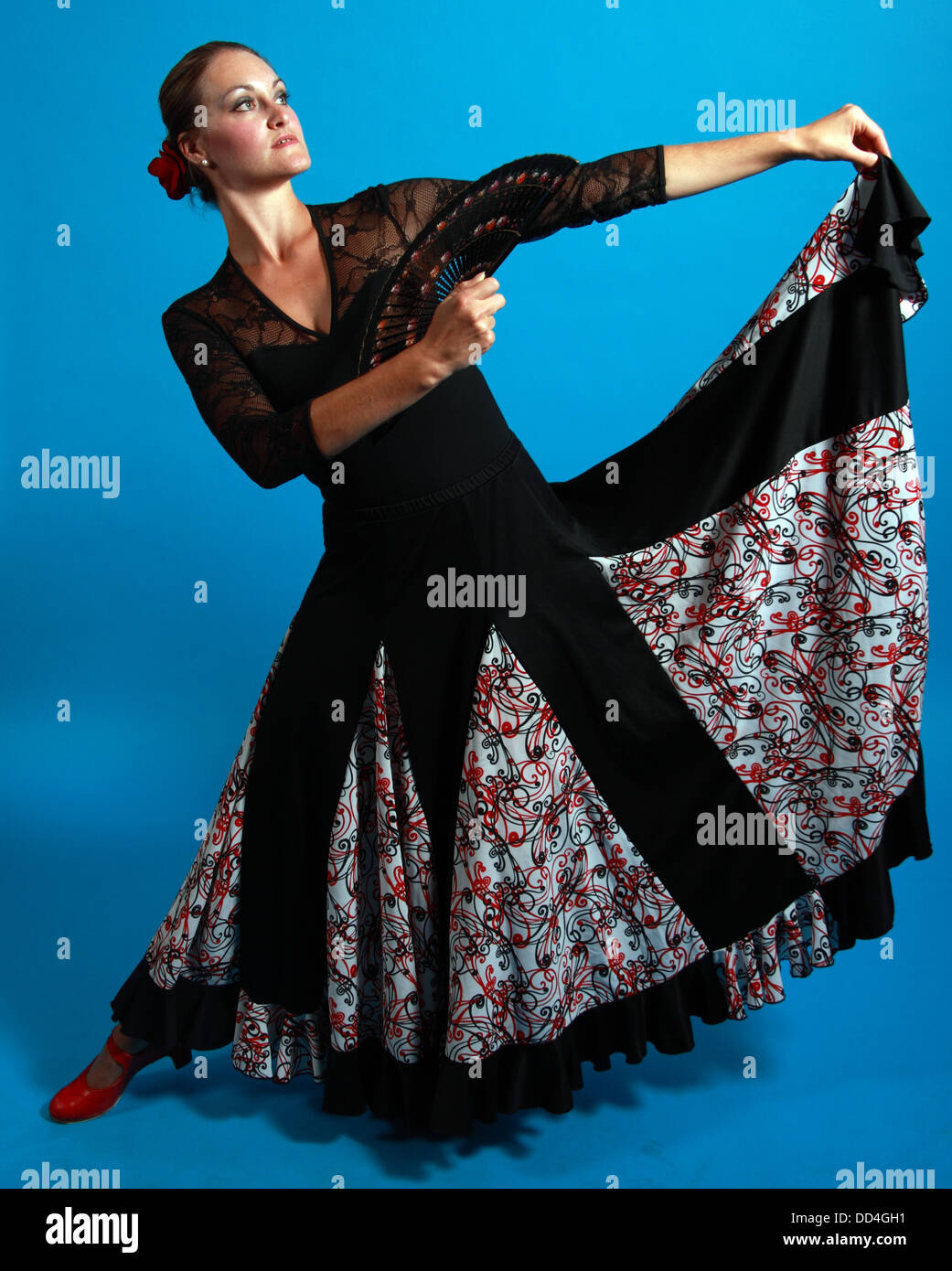 Flamenco dance moves, lady in a black dress with fan Stock Photo