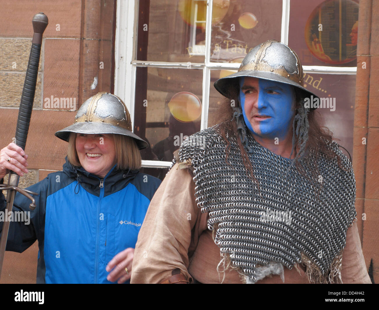 Street Actor on Castlehill, Edinburgh as Scottish Medieval Soldier during Edinburgh Fringe Festival, Scotland, UK - Stock Image