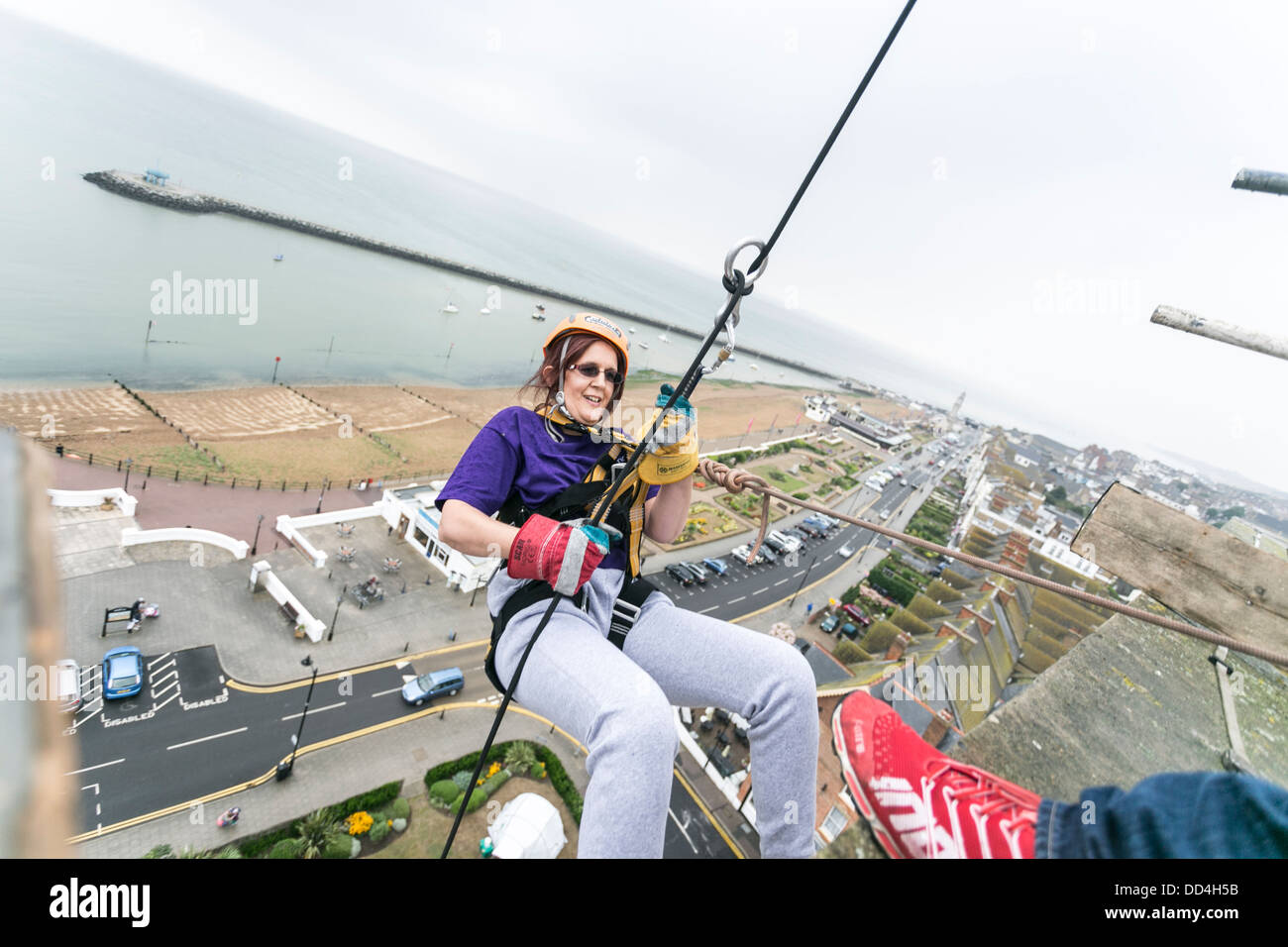 People Abseiling from a tower block for charity Stock Photo
