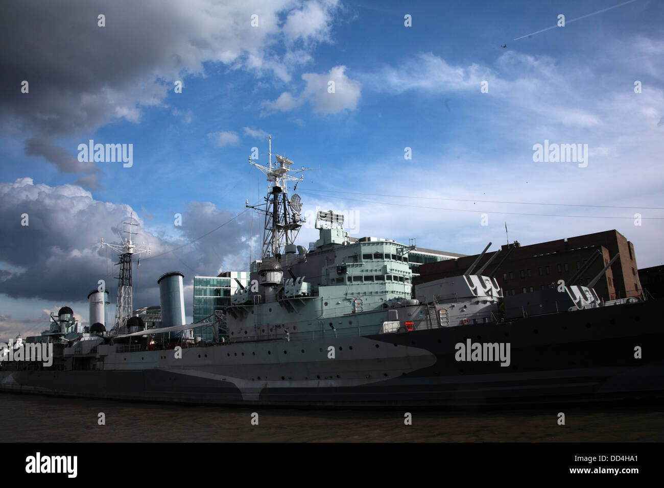Moody image of the HMS Belfast, moored on the Thames river, London, South East England, UK - Stock Image