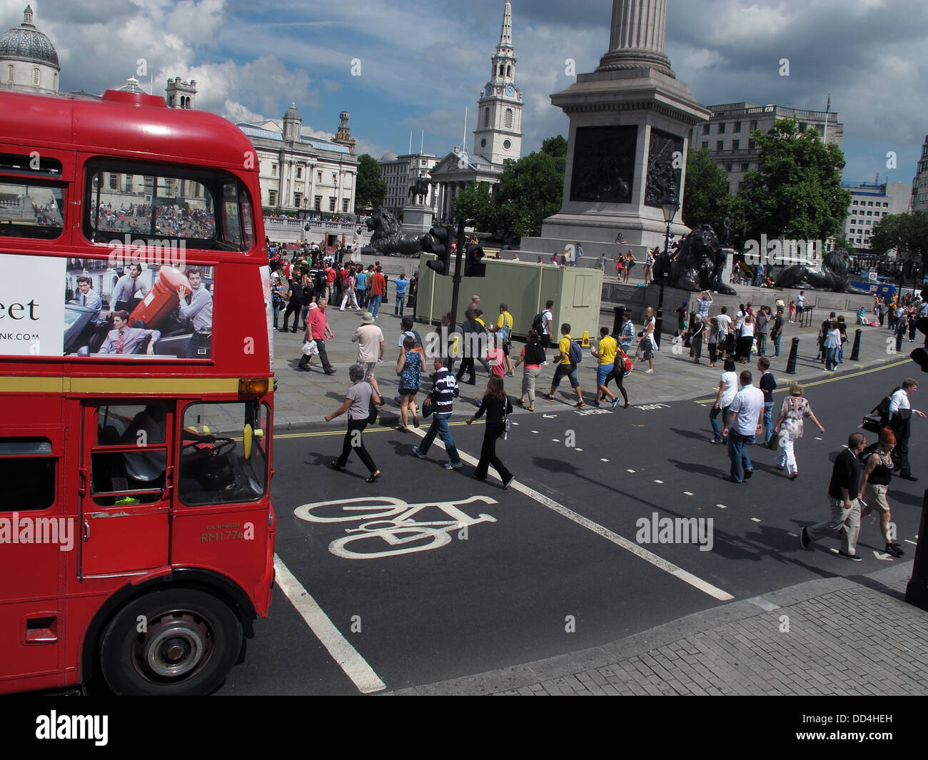 Red London Double Decker bus, at Trafalgar Square, Central London, South East England, UK - Stock Image