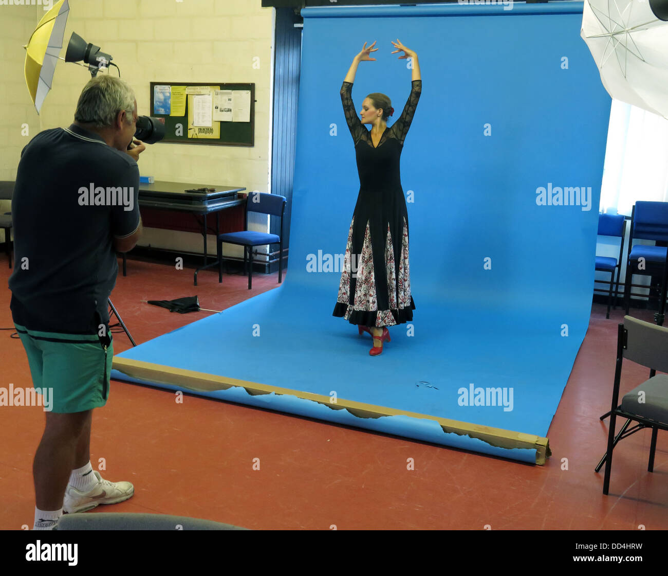 Photographer taking a studio portrait of a dancer, at a photographic society studio night - Stock Image