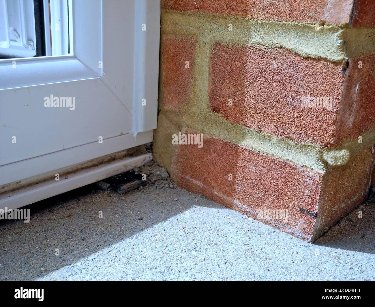 Bad brickwork badly laid bricks - Stock Image