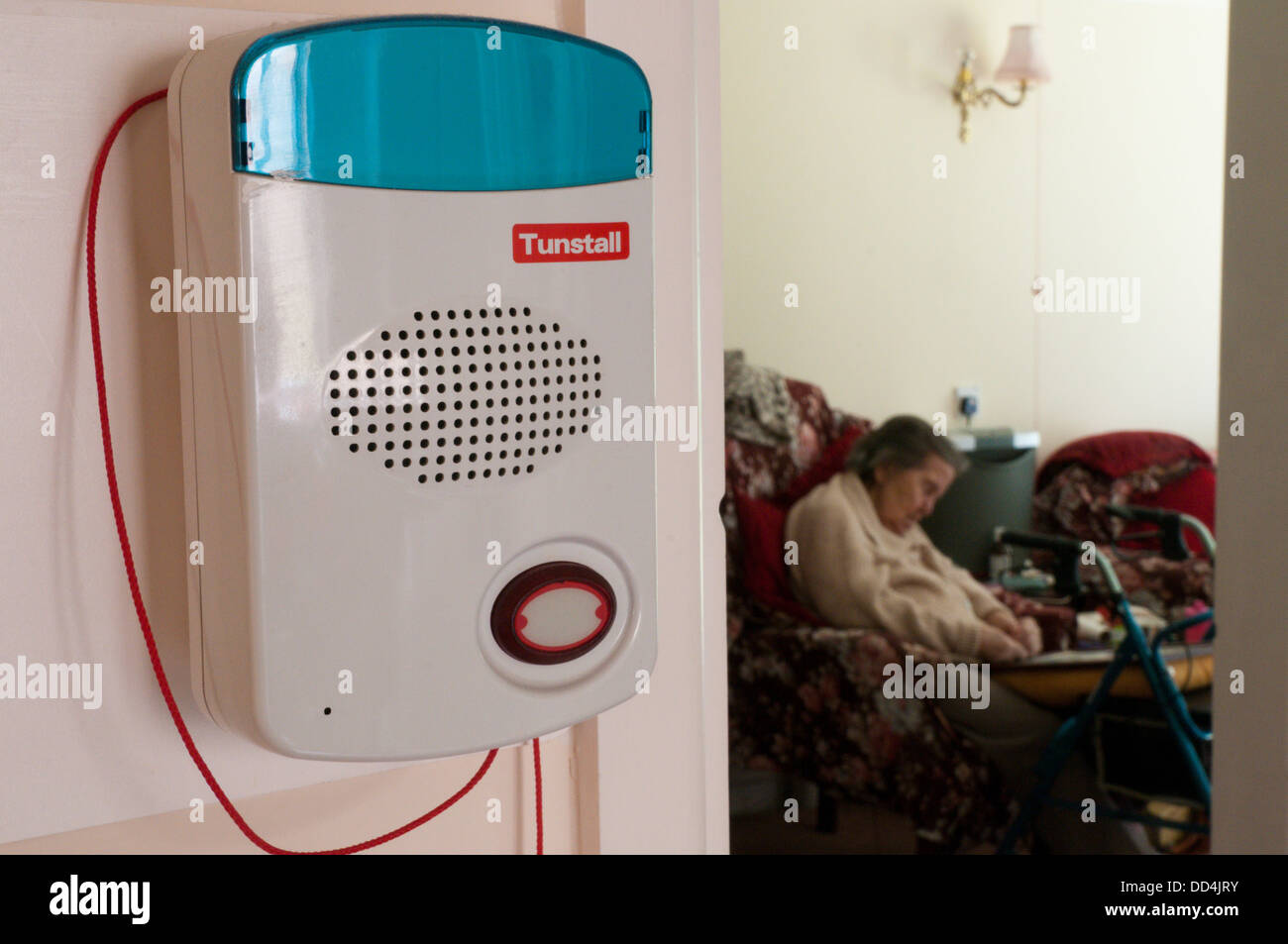 An old lady sleeps in her warden assisted bungalow with a warden call alarm system and pull cord for any emergency. - Stock Image
