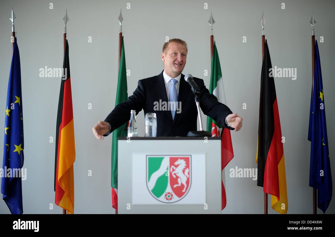 North Rhine-Westphalian Minister Ralf Jaeger speaks to representatives of charitable organizations, who he presented - Stock Image