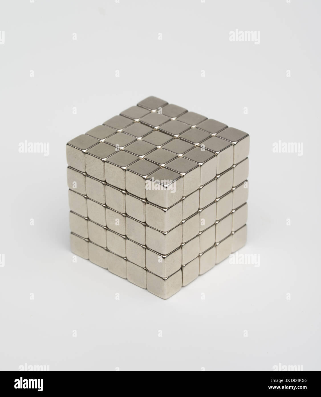 Neodymium magnet educational toy. Nickel-plated magnetic cubes. Toys banned in the US due to cases of children swallowing - Stock Image