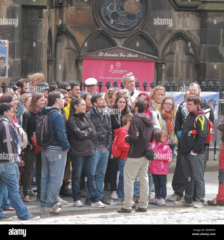 Tour Guide with Tourists Outside St Columba's Free Church, Johnston Terrace, Scotland, UK - Stock Image