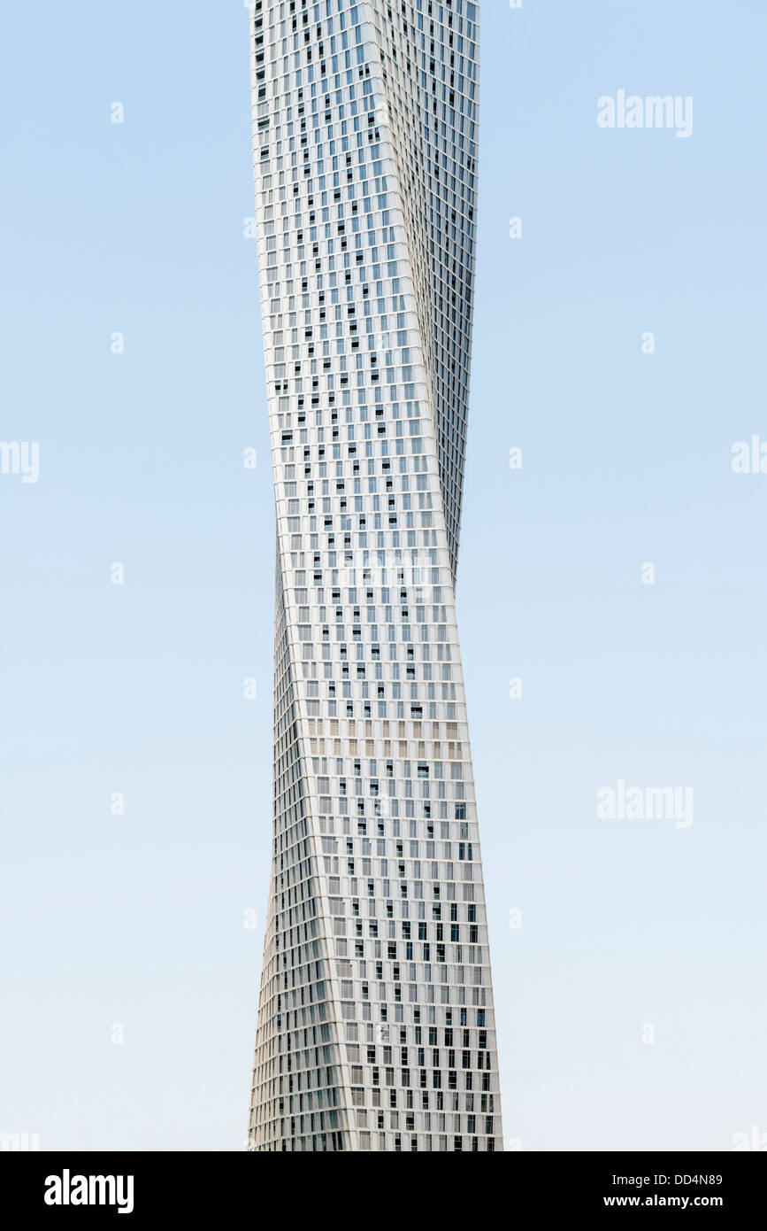 View of new Cayan Tower a modern skyscraper with twisted design in Marina district of Dubai UAE - Stock Image