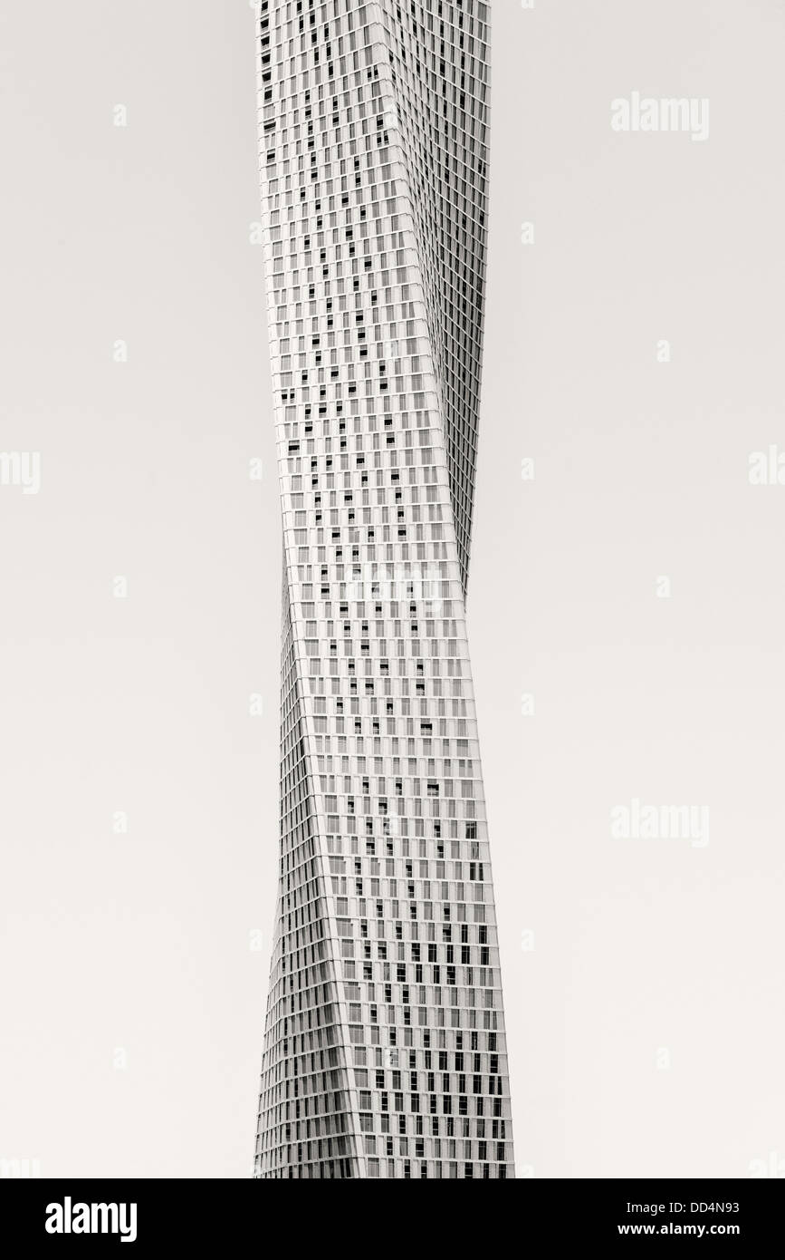 View of new Cayan Tower a modern skyscraper with twist in Marina area of Dubai UAE - Stock Image
